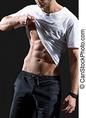 Attractive guy showing his muscular body