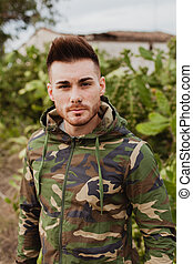 Attractive guy with military jacket