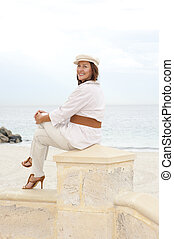 Attractive happy retired woman high heels holiday - Portrait...