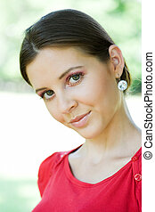 Attractive happy young brunette woman.