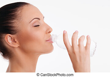 Attractive healthy woman with perfect skin is thirsty - ...