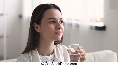 Attractive healthy young woman holding glass drinking fresh ...