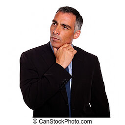 Portrait of a attractive hispanic broker meditative while thinking on black suit on isolated background