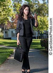 Attractive hispanic business woman working outdoor