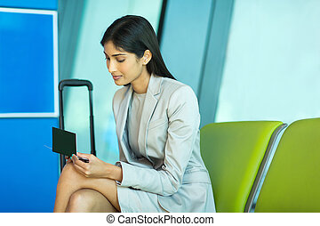 indian business woman looking at her air ticket