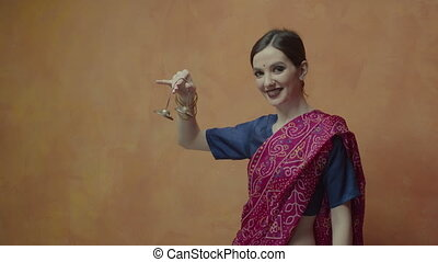 Attractive indian female in sari showing karatalas - Smiling...