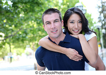 Attractive Interracial Couple in Love - An Attractive man...