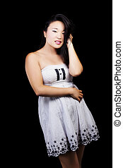 Attractive Japanese American Woman Standing In Dress