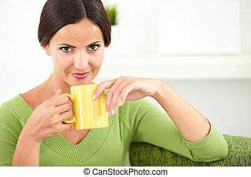 Attractive lady holding a coffee cup