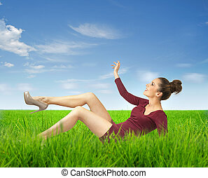 Attractive lady lying on grass
