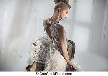 Attractive lady wearing a luxury white gown