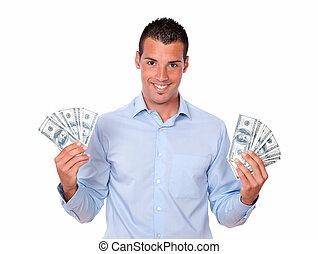 Attractive latin man holding his money
