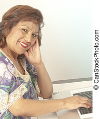 Attractive Latino at laptop