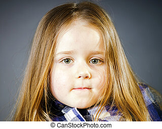 Attractive little girl close-up portrait, isolated on black