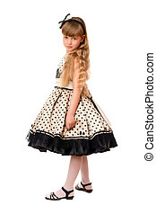 Attractive little girl in a dress