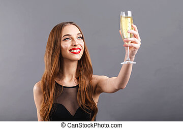 Attractive Long Haired Woman Drinking A Glass Of Champagne
