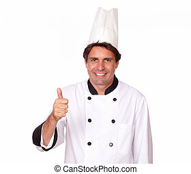 Attractive male chef gesturing positive sign