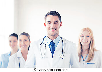 male doctor in front of medical group