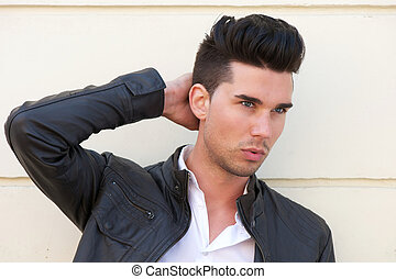 Attractive male fashion model with hand in hair - Closeup ...