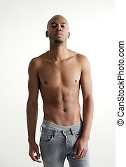 Attractive male model standing on white background