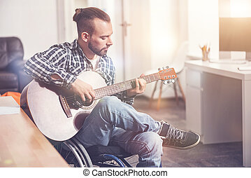 Attractive male person making melody