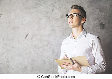 Attractive male with notepad