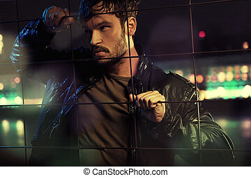Attractive man behind metal fence - Attractive guy behind...
