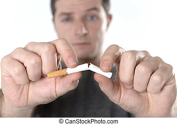 attractive man breaking cig - Man breaking cigarette with ...