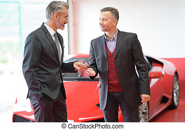 attractive man buying a car