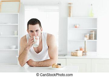 Attractive man having breakfast