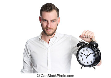 Attractive man holding a clock - An attractive man wearing a...