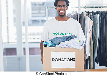 Attractive man holding a donation box