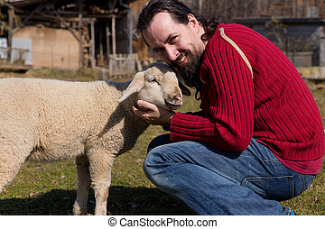 Attractive man hugging a cute lamb