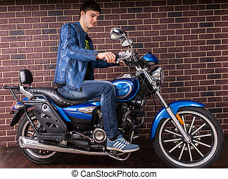 Attractive Man in Casual Outfit on his Motorbike