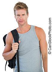 Attractive man in sportswear gesturing on white background