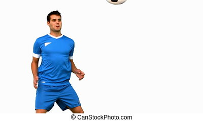 Attractive man juggling a football