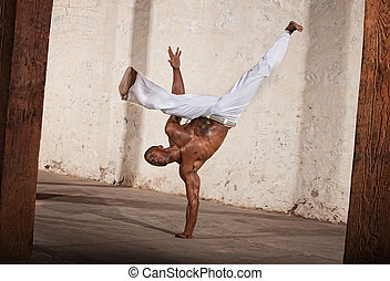 Attractive Man Kicking
