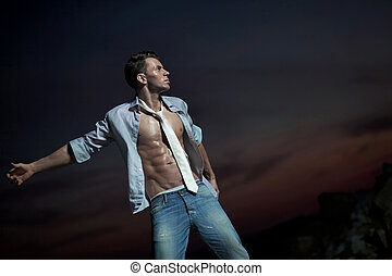 Attractive man over evening sky