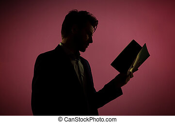 Attractive man reading the book