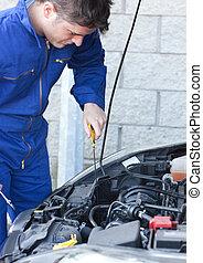 Attractive man repairing a car