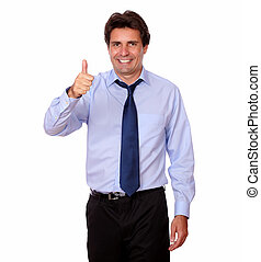 Attractive man standing with ok thumb
