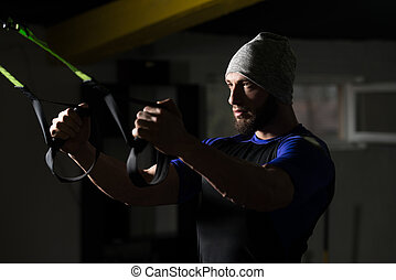 Attractive Man Training With Trx Fitness Straps - Attractive...