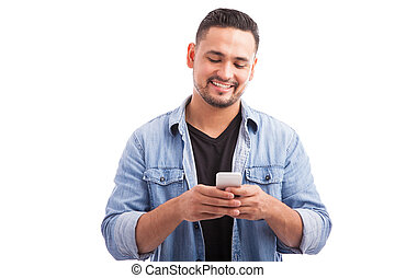 Attractive man using a smartphone