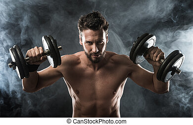 Attractive man weightlifting - Attractive shirtless man...