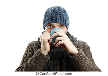 Attractive man with a cup of tea in his hands