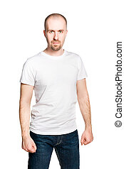 Attractive man with clenched fists in white t-shirt and blue...