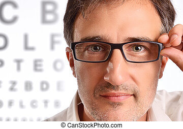 Attractive man with eye corrective glasses in consultation
