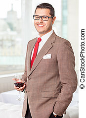 Attractive man with eyeglasses is relaxing in restaurant