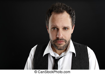 Attractive man with white shirt and black tie looks into the ca