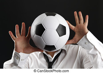 Attractive man with white shirt and football